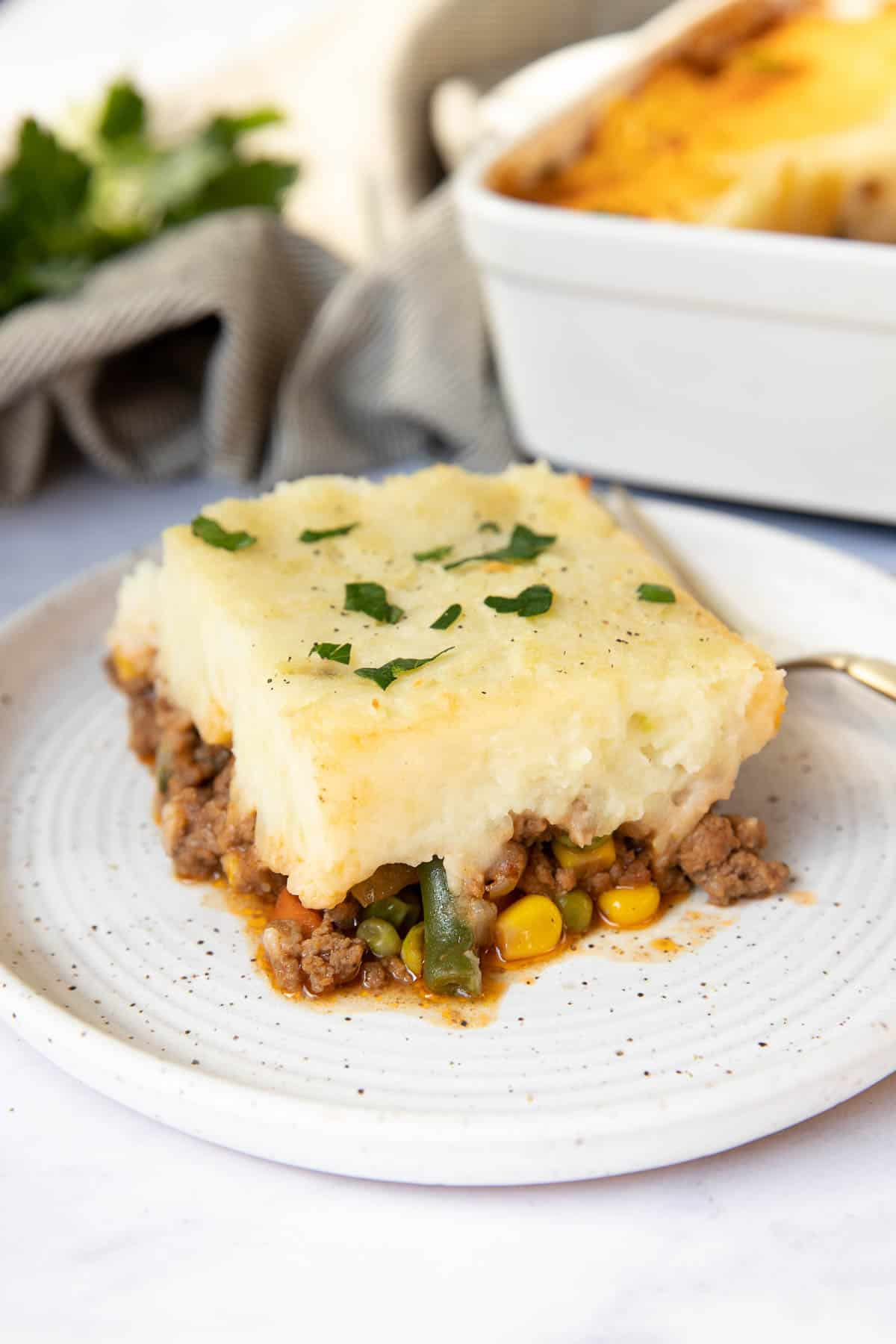 Slice of cottage pie for two on a plate.
