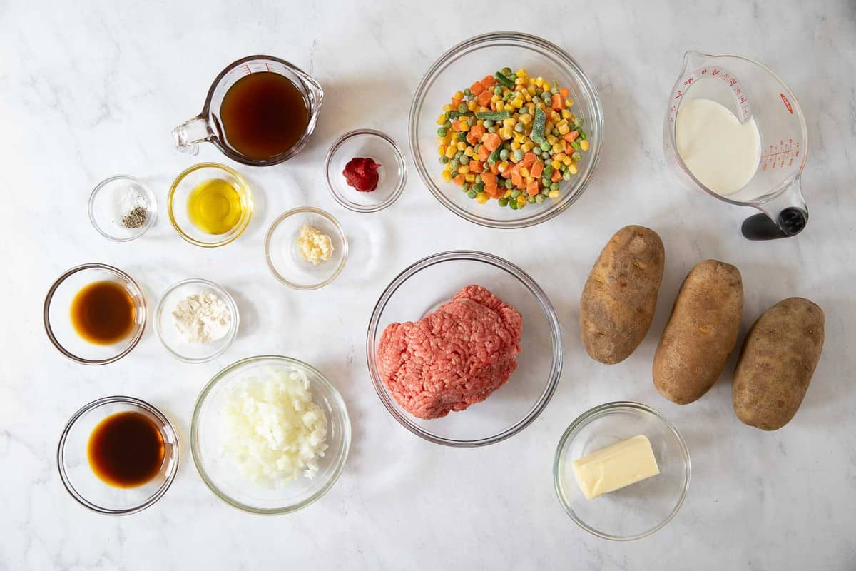 Ingredients for cottage pie for two in small bowls.