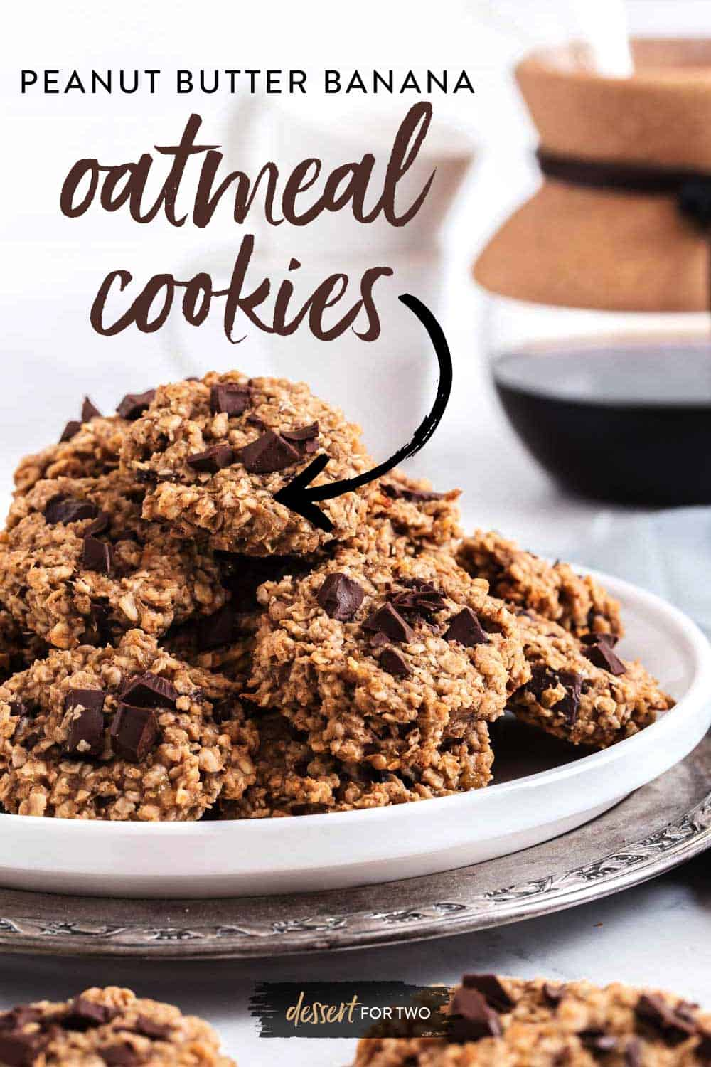 White plate of oatmeal cookies with chocolate chunks.