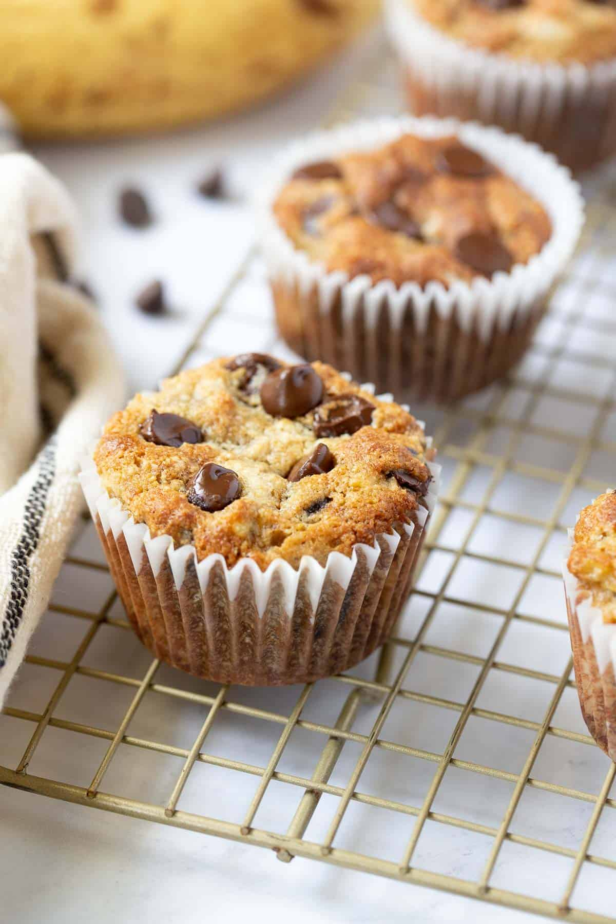 Close up of banana muffin with chocolate chips on top.