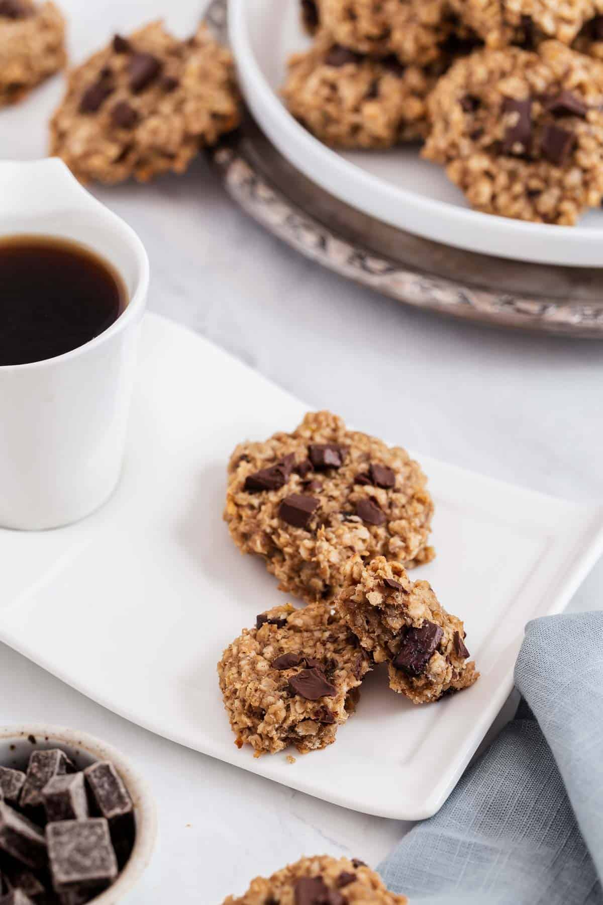 Oatmeal chocolate chunk cookies with a cup of coffee.