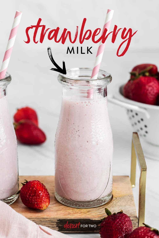 Strawberry milk in a glass jar with straw.
