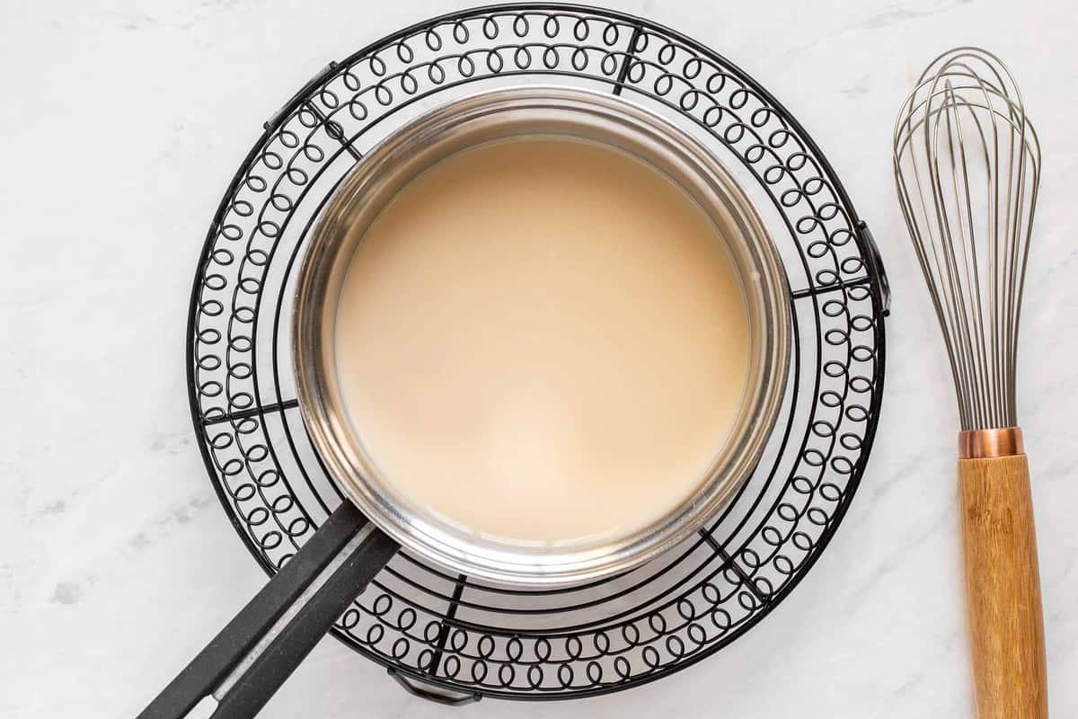 Caramel and milk in saucepan.