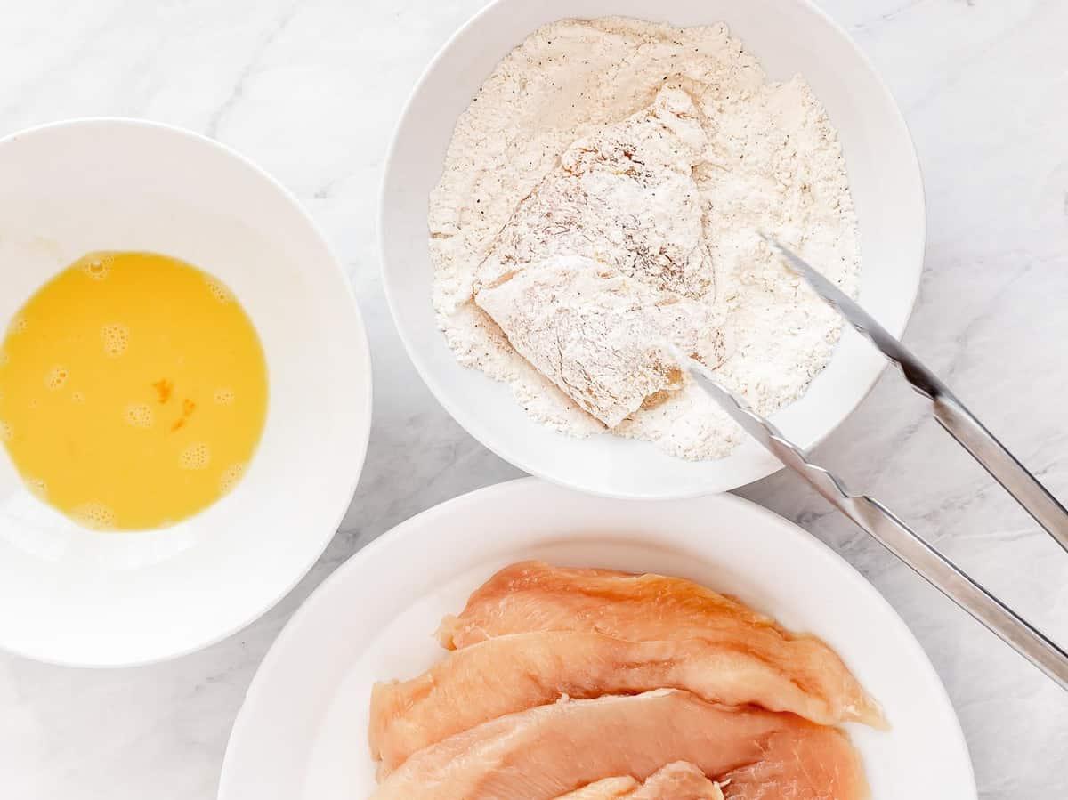 Chicken cutlet dredged in flour.