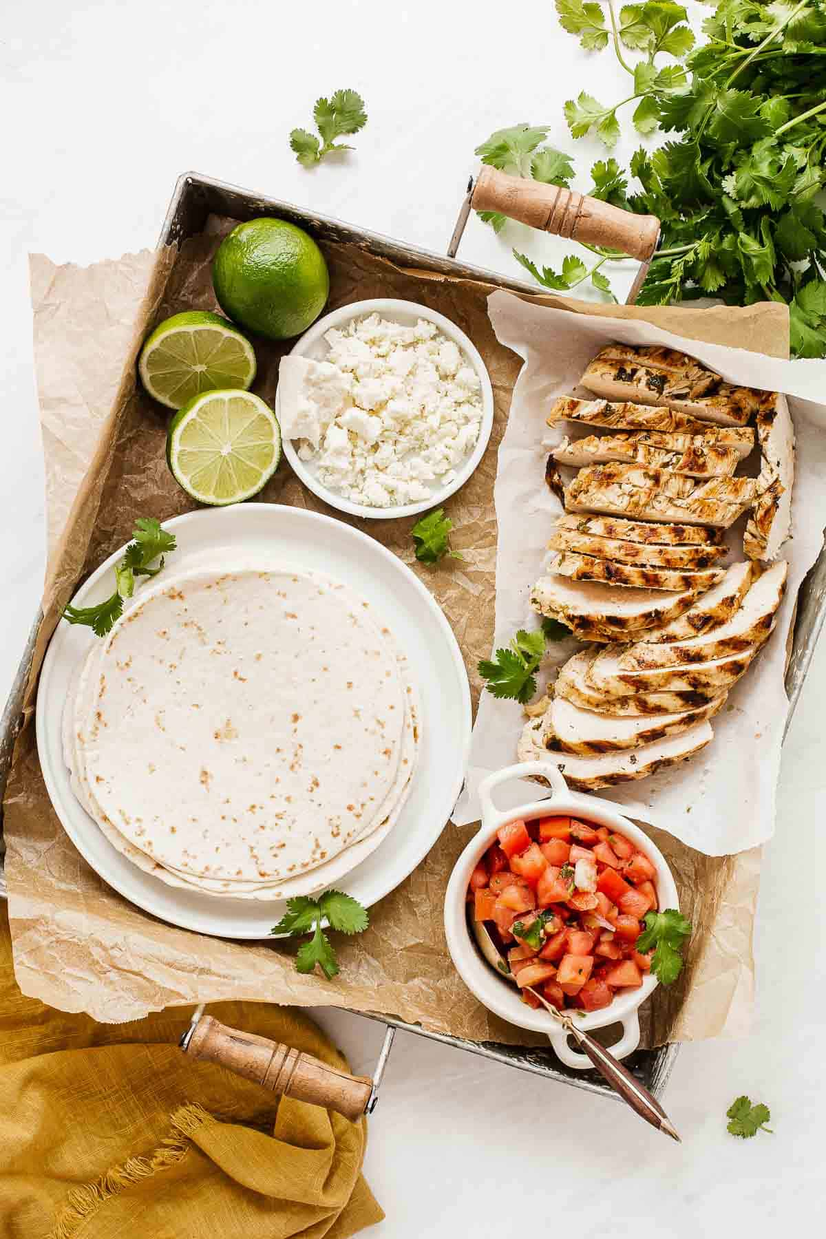 Board of chicken taco ingredients.