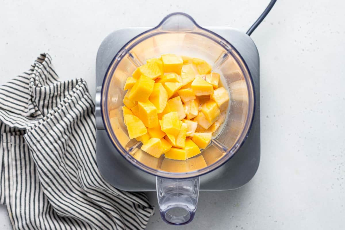 Frozen fruit in a blender.