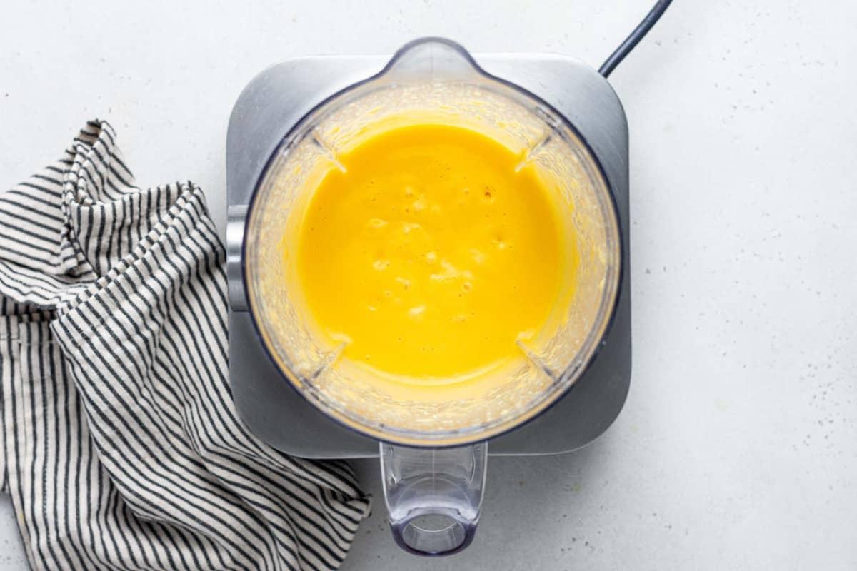 Mango mousse in a blender.