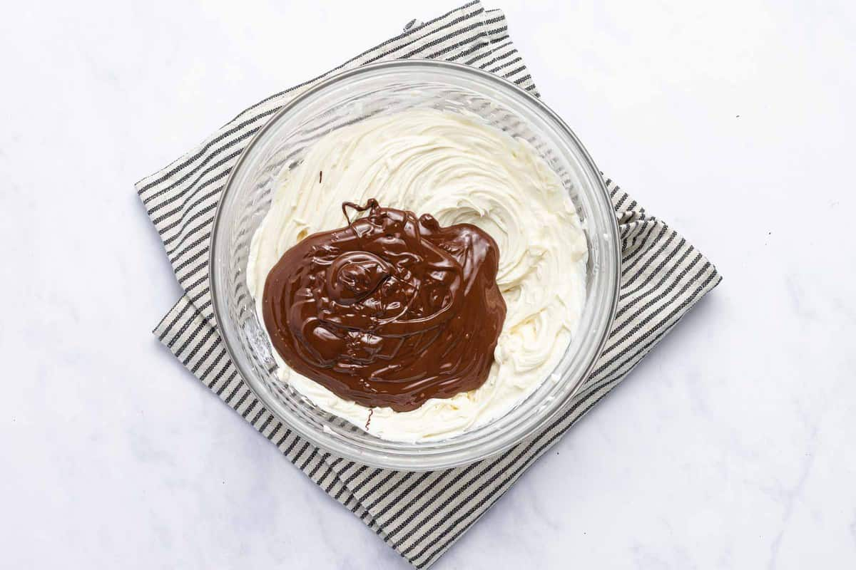 Cheesecake mixture with melted chocolate on top.