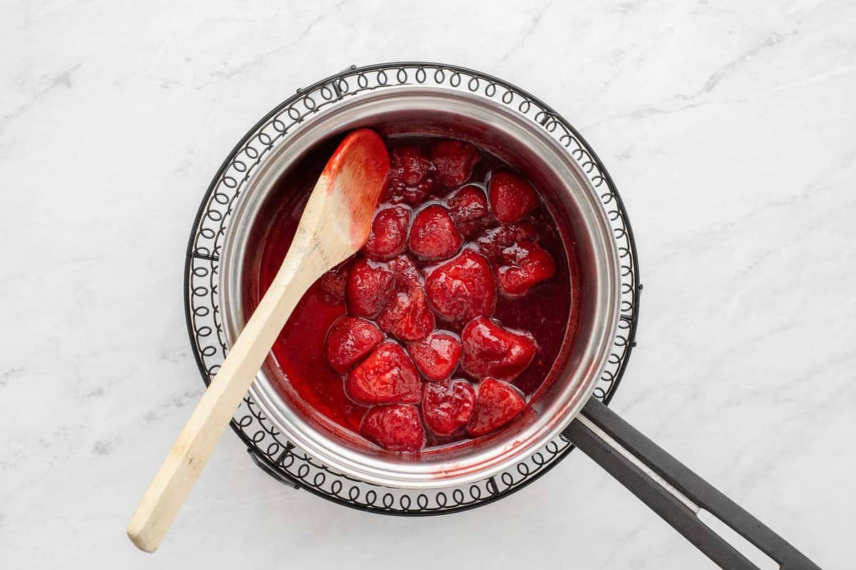 Cooked strawberries in a pan.