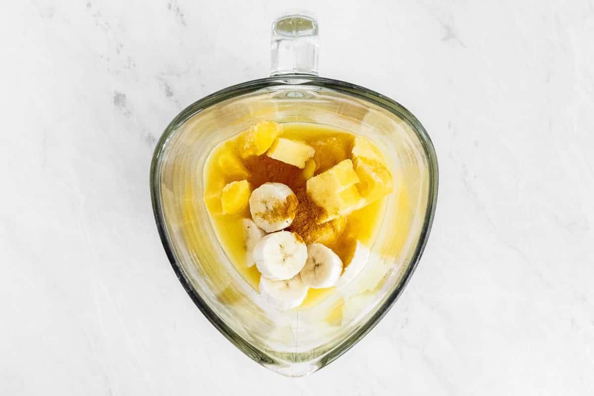 Diced fruit in blender cup.