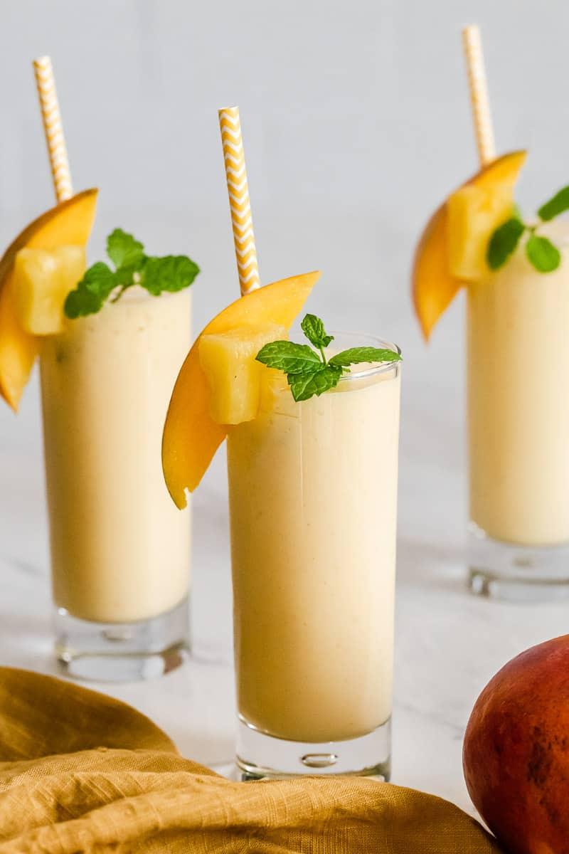 Mango smoothies in three glasses.