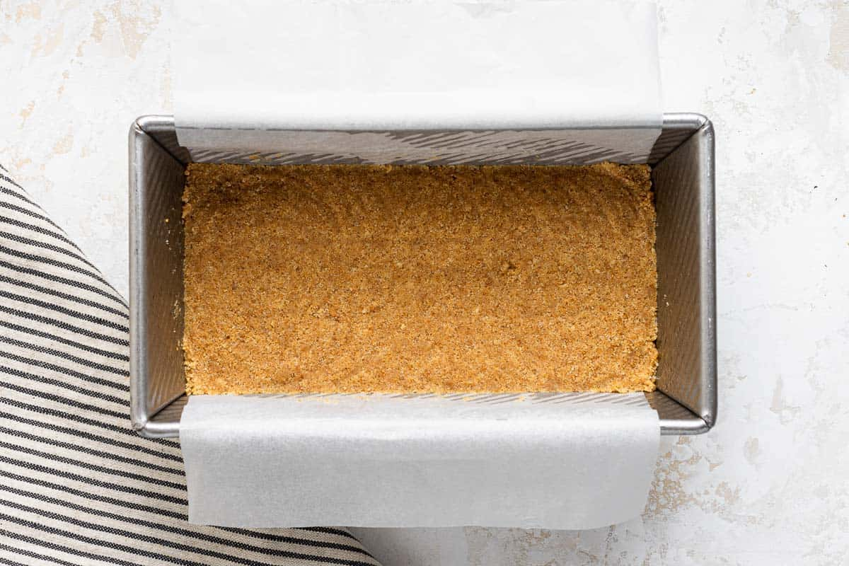 Graham cracker crust in a bread loaf pan.
