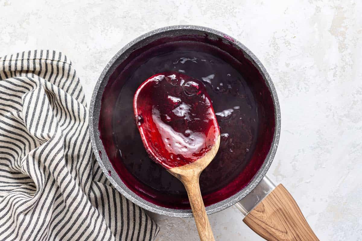 Homemade fresh blueberry sauce in pan.