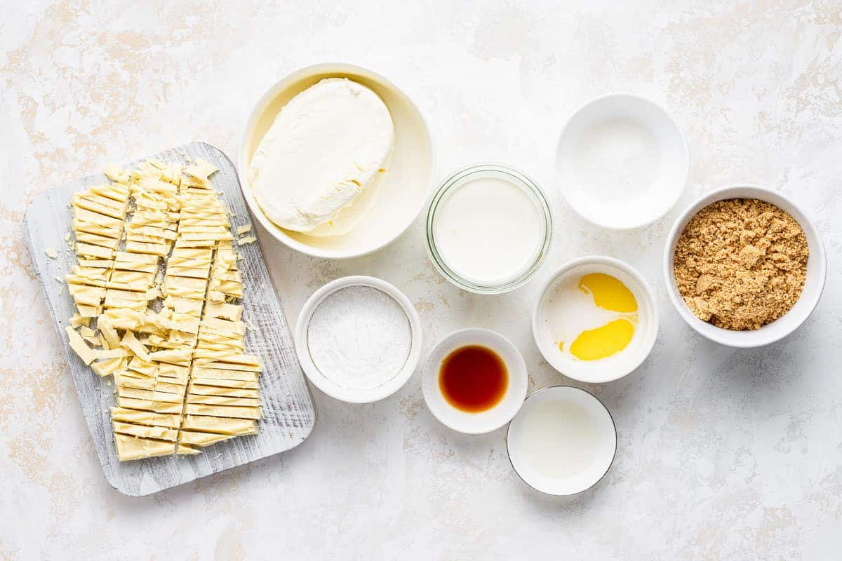 Ingredients for no bake cheesecake on a white table.