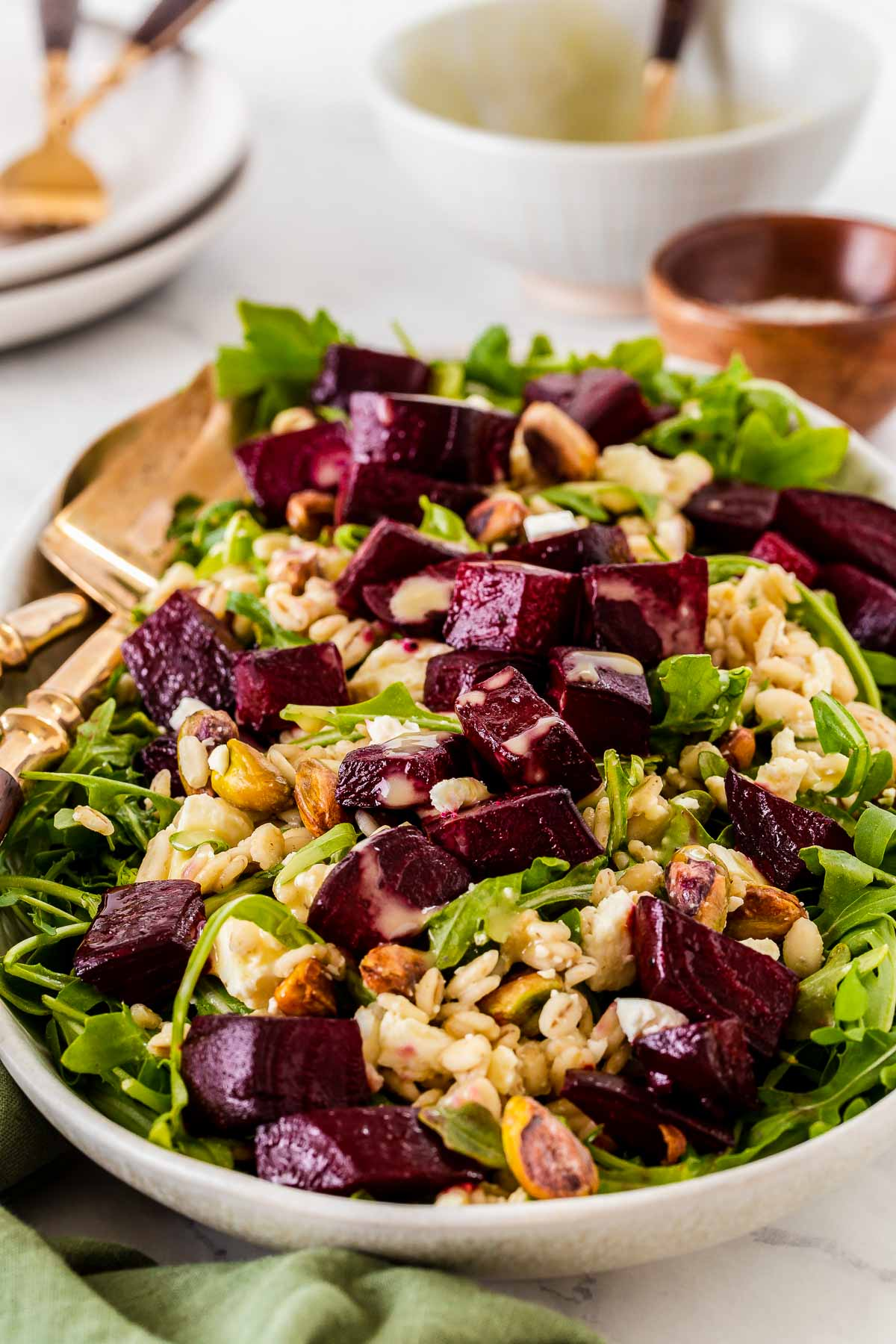 Rectangle platter of beets on rocket with barley.