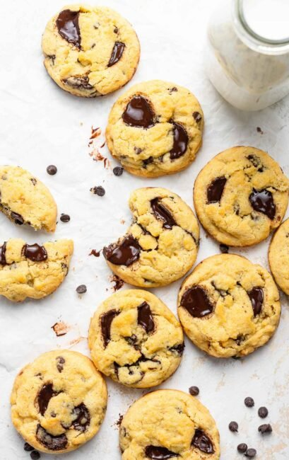 Chocolate chip cookies without brown sugar on a white table.