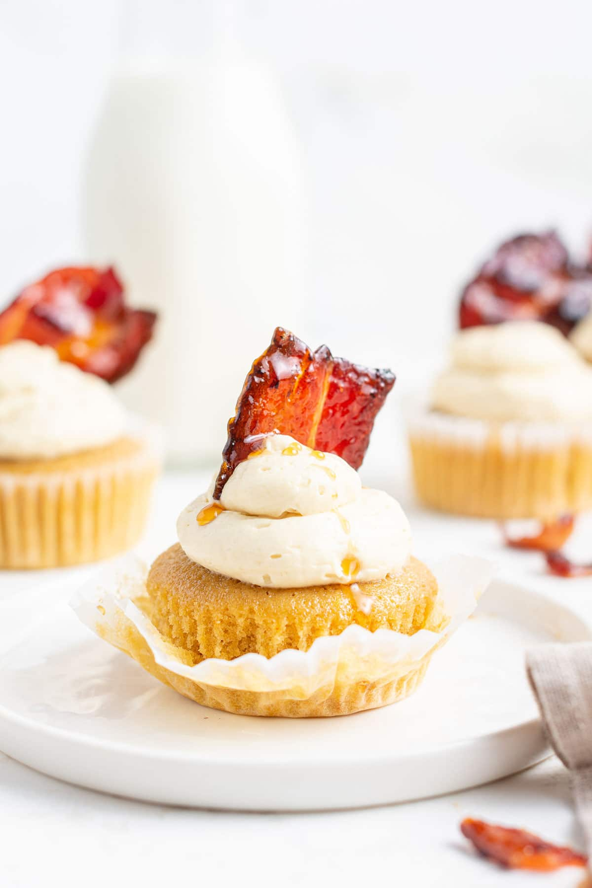 Bacon on top of maple cupcakes.
