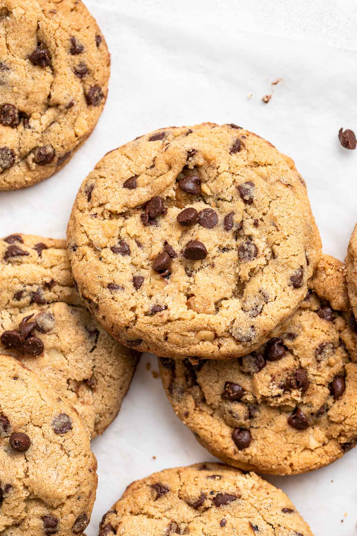 Cookie close up with chocolate chips and walnuts.